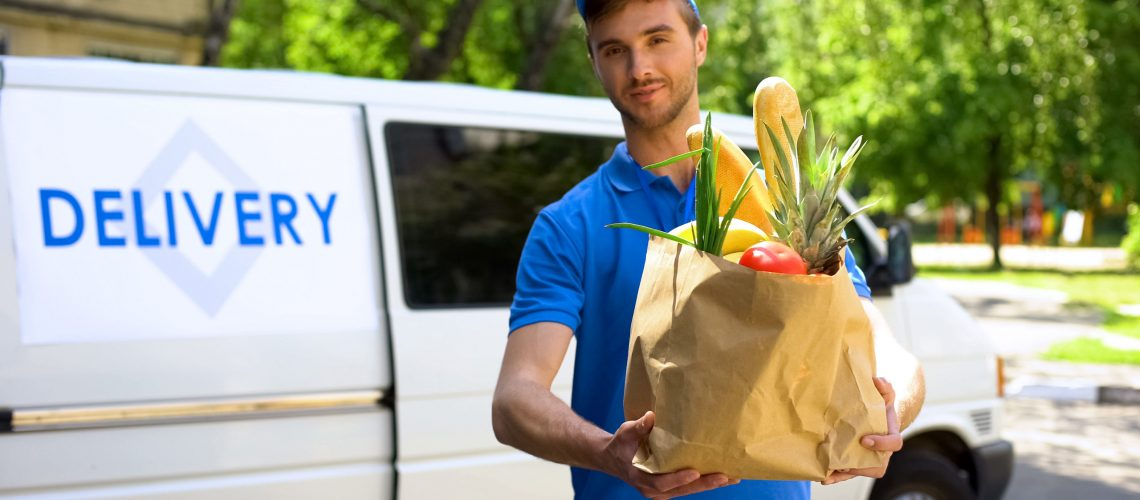 Delivery company worker holding grocery bag, food order, supermarket service
